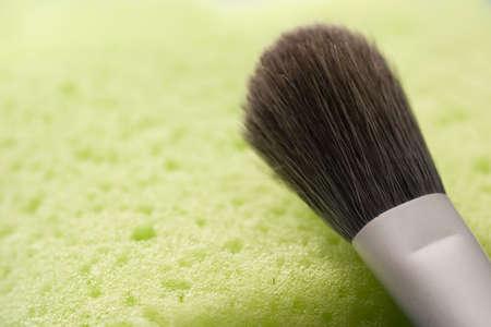 make up brush and washing sponge Archivio Fotografico