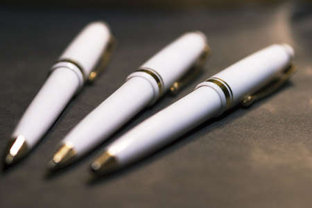 pens on black background with selective focus Stock Photo