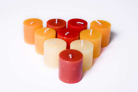 triangle of red tones candles