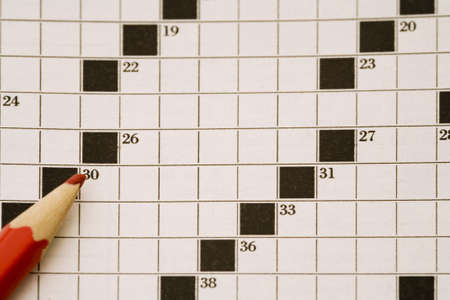 inddor: crossword page and a red pencil
