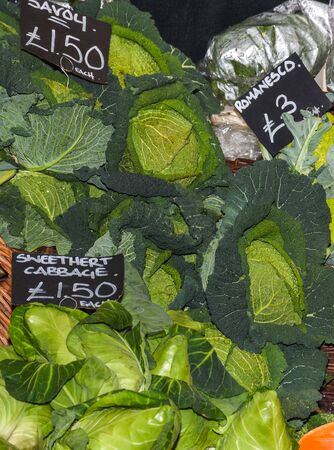 Assortment of fresh salads and vegetables at the market: sweetheart cabbage, savoy, cauliflower Banco de Imagens