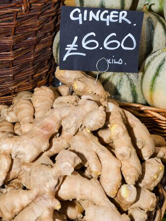 Ginger for sale. Local produce for sale displayed at the market. Borough farmer's market in London. Organic and bio fresh healthy eating concept. Veggies, vegetables, herbs and spices, price tags