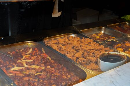 Asian food specialties, street food for sale at the market. Live cooking station. Fresh Food Buffet Brunch Catering Dining Eating Party Sharing Concept