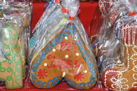 Gingerbread men and gingerbread hearts, figurines and Christmas shapes in wicked basket. Traditional czech sweet dessert gingerbread at the Christmas Market in Prague. Souvenir sale concept