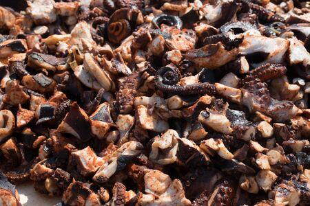 Octopus small chopped bites, street food festival. Seafood festival. Live cooking session contest. Fresh Food Buffet Brunch Catering Dining Eating Party Sharing Concept. Finely chopped octopus tentacl