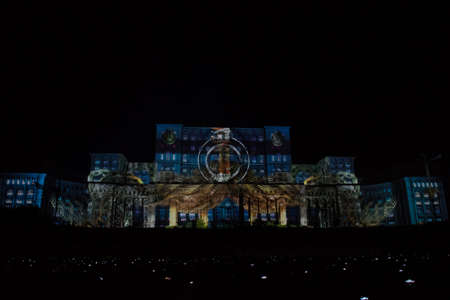 Bucharest, Romania, 21st of September 2019: Projections on Palatul Parlamentului landmark building in Bucharest. The Parliament bathed in light with images for the IMAPP 2019 VideoMapping competition