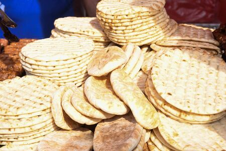 Pile of fresh pita flat bread. Gluten free lebanese or greek specialty. Grilled or oven baked. Food festival for sale during outdoor event Stock Photo