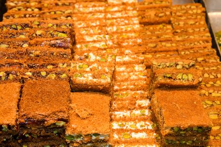Traditional baklava sweet dessert delights, cataif pastry during hotel brunch buffet outside outdoor in the garden by the pool. Fresh Food Buffet Brunch Catering Dining Eating Party Sharing Concept
