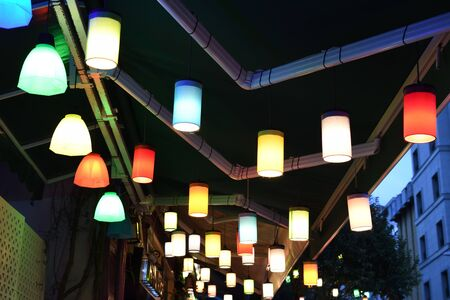 Beautiful turkish light bulbs lamps on Istanbul bazaar. Multi colored light lampions hanging