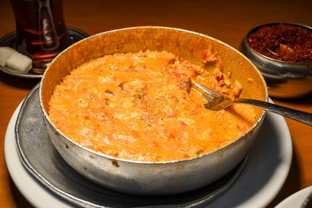 Traditional turkish food breakfast dish menemen made by eggs and tomatoes and different fillings ingredients like sausage, meat, cheese, sauce and spices. Fresh Food Buffet Brunch Catering Dining