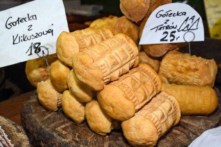 Oscypek, Oszczypek (Polish; plural: oscypki) is a smoked cheese made of salted sheep milk exclusively in the Tatra Mountains region of Poland.