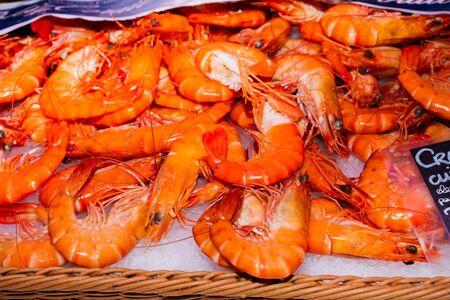 Closeup on fresh prawns in a market place
