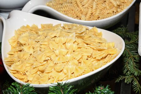 Fresh cooked simple no sauce pasta during brunch buffet