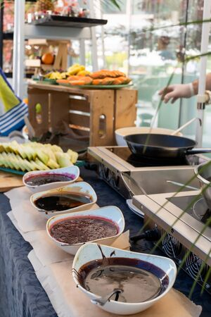 Candy bar food buffet by the pool, during hotel brunch, catering in the garden, food bloggers event, banquet, wedding, festive sweet dessert celebration party,fruit. Chef live pancakes cooking station