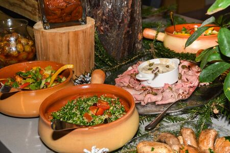 Tabbouleh is a Levantine vegetarian salad made mostly of finely chopped parsley. Fresh Food Buffet Brunch Catering Dining Eating Party Sharing Concept 스톡 콘텐츠