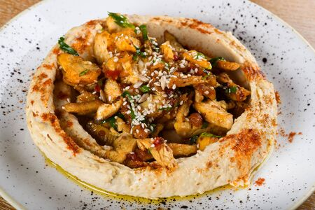 Hummus is a dip, spread, or savory dish made from cooked, mashed chickpeas blended with tahini, lemon juice, and garlic. It is popular in the Middle East and Mediterranean, as well as in Middle East
