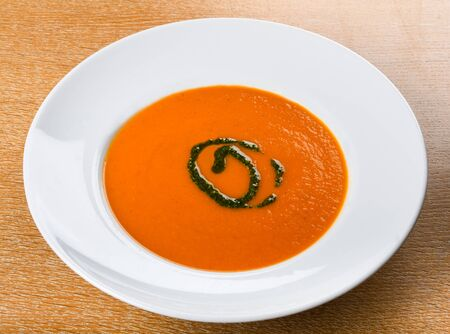 Tomato soup is a soup made with tomatoes as the primary ingredient. It may be served hot or cold in a bowl, and may be made in a variety of ways. It may be smooth in texture