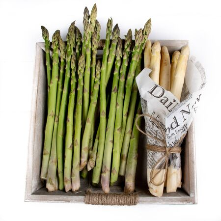 Green and white asparagus. Local produce for sale displayed at the market. Borough farmer's market in London. Organic and bio fresh healthy eating concept. Veggies, vegetables, herbs and spices, price Stock fotó