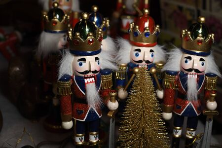 Army of Nutcrackers for sale during Christmas festival fair in Vienna, Austria. Traditional wooden statue or soldier famous play Ceaikovski. German street Xmas fair with wood nutcrackers in Europe