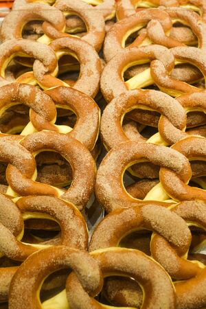 Bavarian authentic pretzels for Oktoberfest or Autumn Fest, Christmas or festive celebration. German or Austrian salted or with seeds brezel bread ideal for morning snack, cut in half with ham, cheese