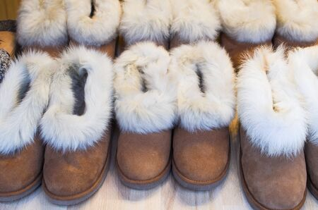 Brown turkish asian arabic indian ugg boots on the counter in the store in Istanbul, Turkey.