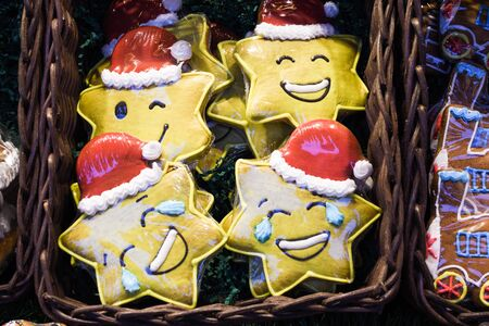 Many gingerbread cookies over the counter, during Vienna Christmas Market. Heart, snowflake, unicorn shape sweet dessert for sale,festival winter celebration. Merry Christmas candy bar buffet concept