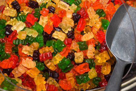 Fruit jelly gummy candies assortment. Background from colorful sweets of sugar candies and marmalade. Standard-Bild