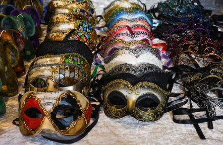 Venetian masks for sale on counter top display Banque d'images