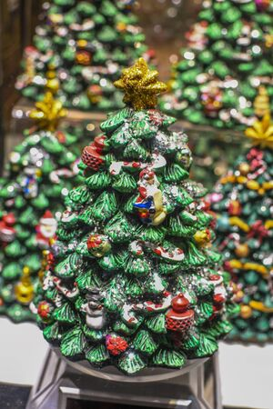 Three Christmas simple decorated tree, with lights, decorations, ornaments, accessories. Shining star on the top 版權商用圖片