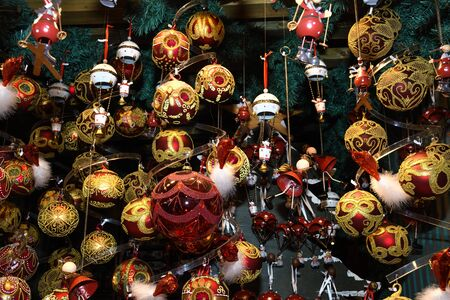 Christmas decorations on the market in Vienna. For sale on Christmas fair in Western Europe, Vienna, Austria. Golden balls, bulbs, bubbles, decorations and ornaments, colored shiny magic fairy tale