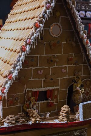 Very large and big ginger bread house display. Natural homemade dessert display during Christmas market in Vienna, Austria Stock Photo