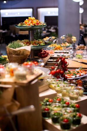 Sunday Brunch Menu with salads, meat, cheese cuts and vegetables during hotel brunch buffet indoor restaurant setting. Standard-Bild