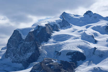 The Monte Rosa massif - Swiss north-western face with several glaciers (with one of the largest Alpine glaciers) flowing towards the Mattertal with Zermatt.