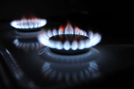 Natural gas flame on stove photo