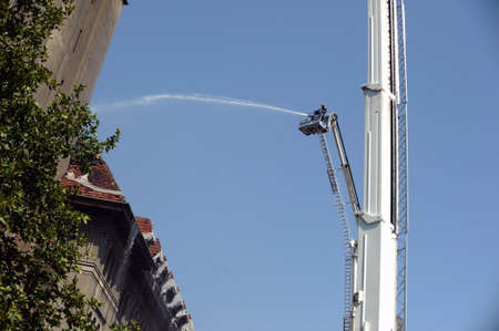 rescuer: Firefighters douse a fire in an old building