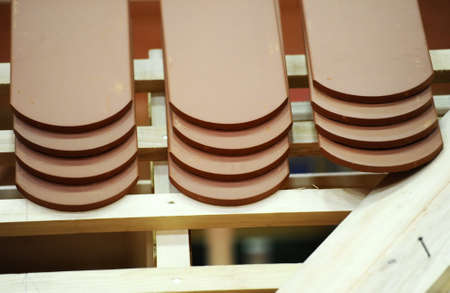 cladding tile: Building a roof made of tiles Stock Photo