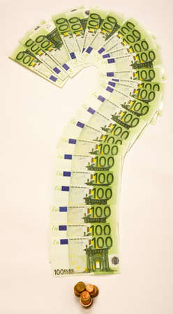 one hundred euro banknote: Question mark made of one hundred euro banknote and eurocent coins as dot