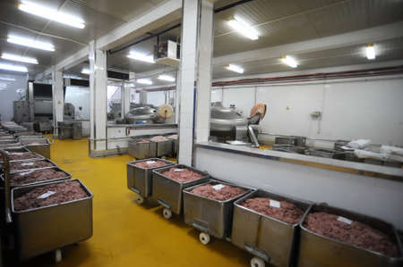 Mince in the containers waiting to be processed in a cold cuts factory