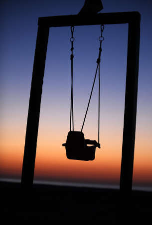 Baby swing on the beach in the dawn photo