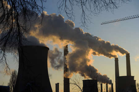 Gray smog from industrial chimneys of heating plant photo