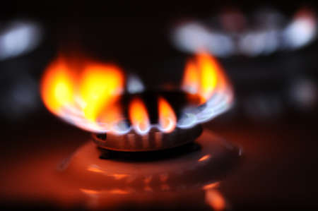 Natural gas flame on the stove photo