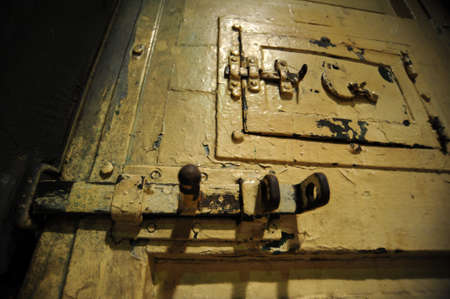 Old, metal, locked door in prison