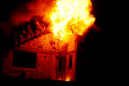 House under construction caught fire by night photo