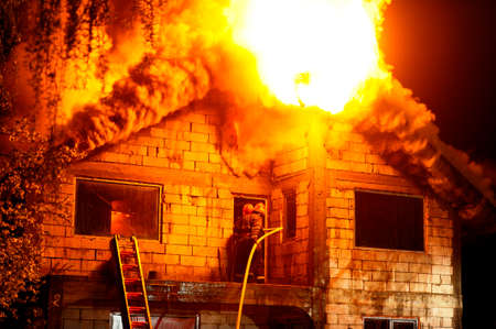 fire brick: House under construction caught fire by night