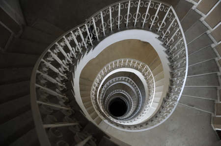 buiding: Spiral staircase in a buiding with many levels