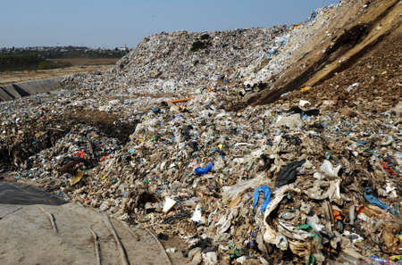 Disposal of waste materials in a garbage dump