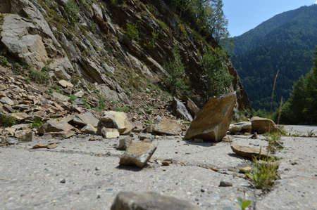 cliff edge: Rockfall in Carpathians where the road is covered with stones
