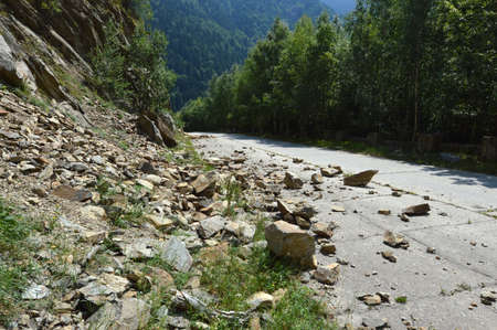 rockfall: Rockfall in Carpathians where the road is covered with stones