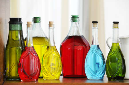 nicely: Colored bottles arranged nicely on the shelf