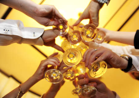 wine glasses: Friends holding glasses of white wine making a toast Stock Photo